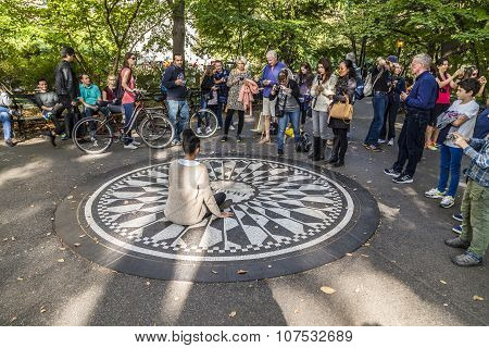 People Having Their Picture Taken On The Imagine Mosaic In Strawberry Fields Central Park