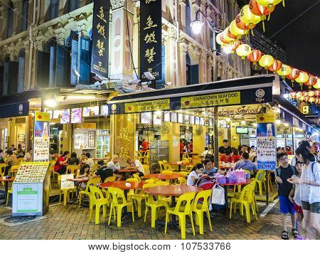 Chinese People Go Eating In The Evening In Chinatown In Singapore