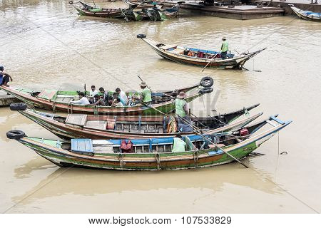 Local People In The Typical Longboats At The Inle Lake