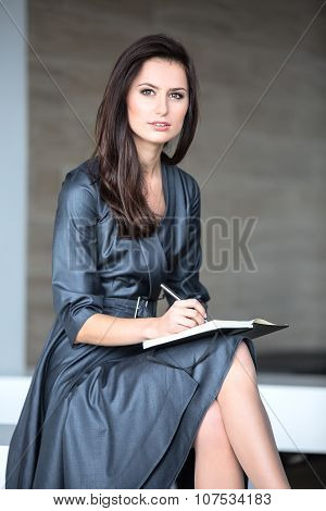 Pretty girl in a gray suit