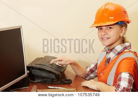 Young Contractor On The Phone In The Office