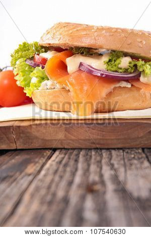 salmon and vegetable on bagel sandwich