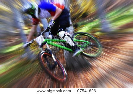Biking as extreme and fun sport. Downhill biking. Biker jumps.