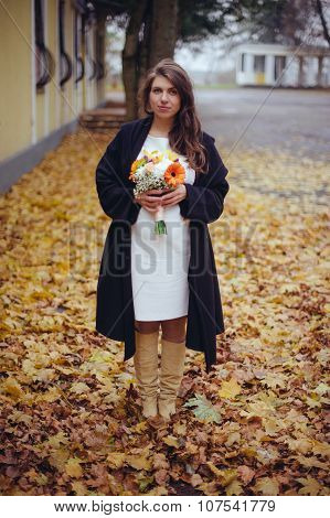 Pregnant girl with a bouquet