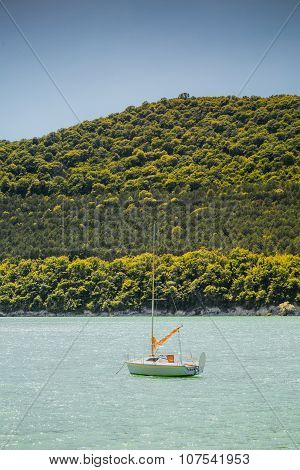 Small sail boat on lake Abrau