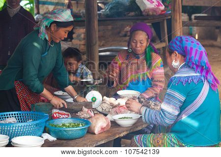 Vietnamese Hmong woman serving traditional noodle and pork at a food course