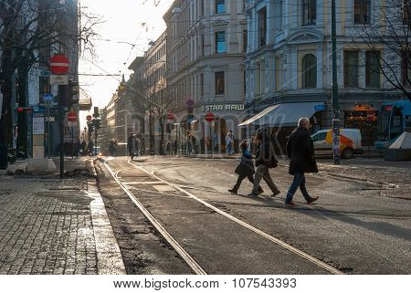 People Crossing Tram Rails In Oslo, Norway