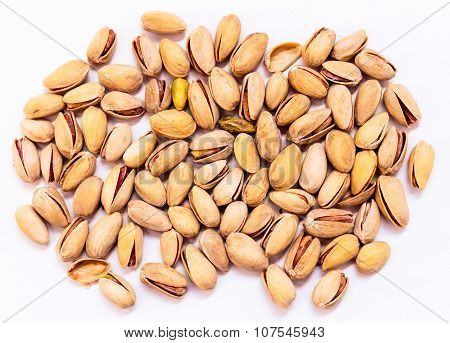Health concepts ~ Salted pistachio kept on a plain white background