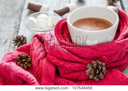 Hot chocolate with marshmallow and pine cones