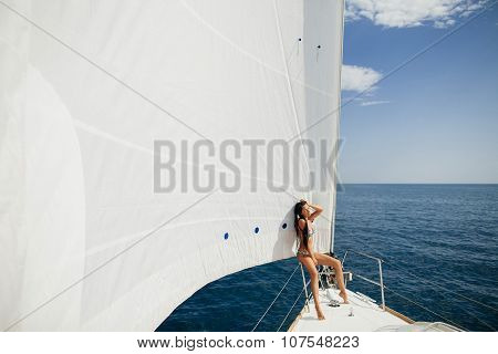 Sexy Girl In Swimwear On Yacht Under Big White Sail