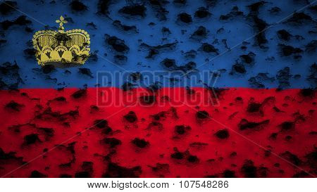 Flag of Liechtenstein painted on wall with bullet holes