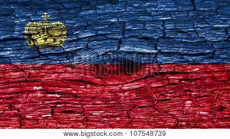 Liechtenstein flag painted on wood texture