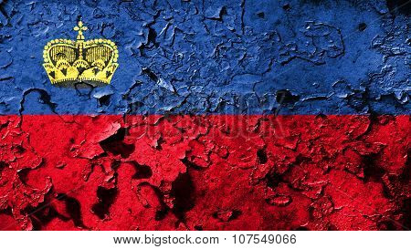 Flag of Liechtenstein painted on cracked paint