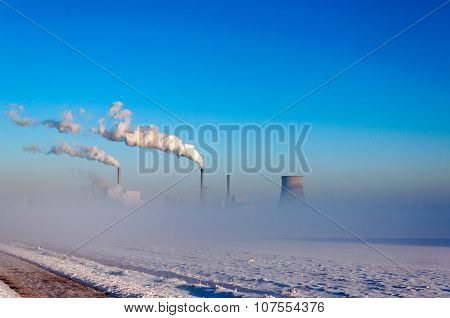 Power Plant In A Snowy Landscape