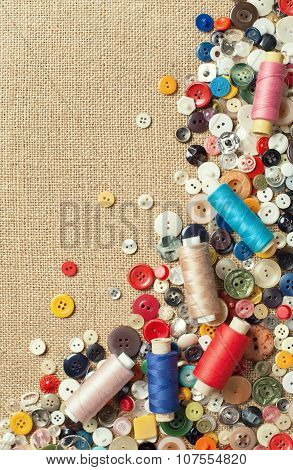 Colourful Sewing Buttons And Spools Of Threads With Copy Space