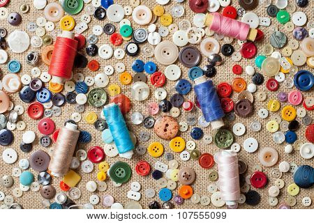 Sewing Buttons And Spools Of Threads Background