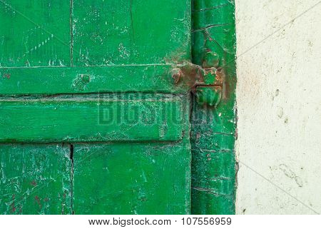 old concrete wall with a door made of planks texture background