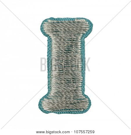 Fonts that are stitched with thread isolated on white capitol letter I