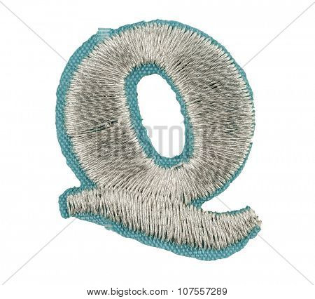 Fonts that are stitched with thread isolated on white capitol letter Q