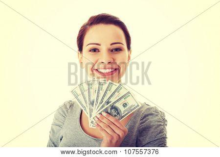 Beatiful casual woman holding money