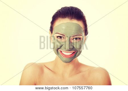 Beautifu toplessl woman with facial mask. Spa concept.