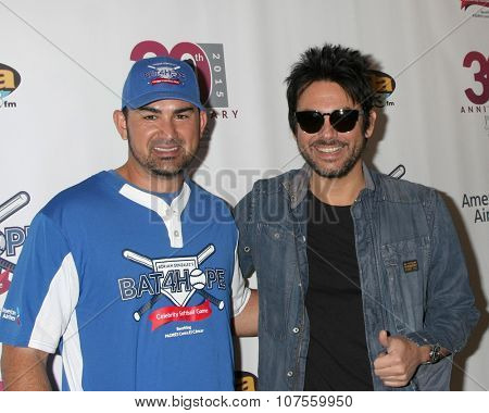 LOS ANGELES - NOV 7:  Adrian Gonzalez, Beto Cuevas at the Adrian Gonzalez's Bat 4 Hope Celebrity Softball Game PADRES Contra El Cancer at the Dodger Stadium on November 7, 2015 in Los Angeles, CA