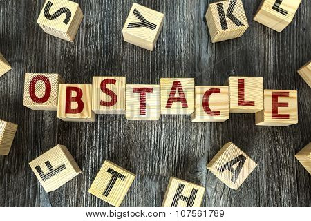 Wooden Blocks with the text: Obstacle
