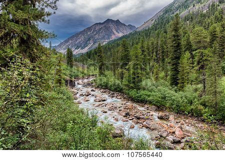 Mountain River In Cloudy Weather