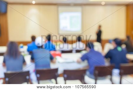Blurred Photo Of Audience Group Attending  In Conference Meeting Room.