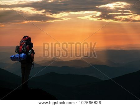 View Of Man On Mountains With Big Rucksack On Back