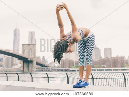 Asian Woman Making Stretching In New York