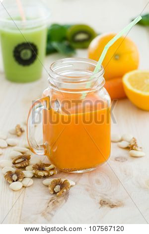 Orange Juice In Glass, Nuts And Fresh Fruits On Wooden Background.