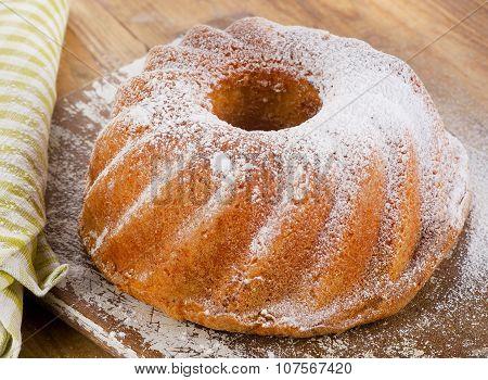 Sweet Sponge Cake On A Wooden Table.