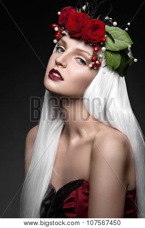 Beautiful girl in white wig, red roses, delicate makeup and wine lips.  Beauty face.