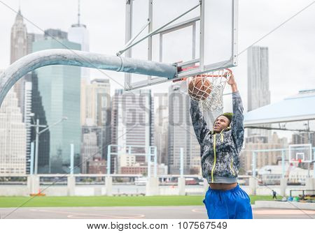 Basketball Player Making A Slam Dunk