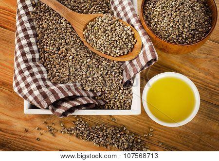 Hemp Seeds And Hemp Oil On A Wooden Table.