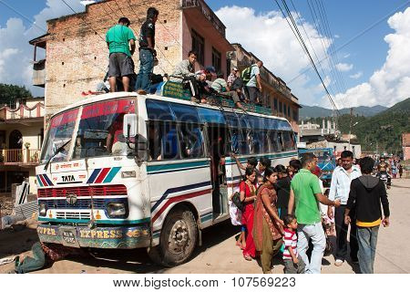 People Traveling On Top Of Autobus Brand Tata