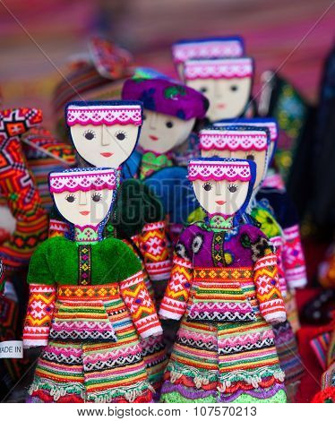 Colorful handmade puppets dressed traditional costumes for sale