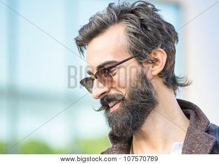 Portrait Of Hipster Guy With Confident Face Expression - Autumn Fashion Male Model Posing Outdoors