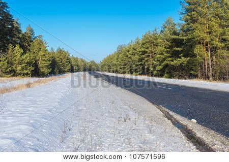 Winter landscape with snow-covered roadside