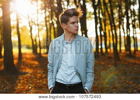 Young Urban Businessman Professional Walking In Park At Sunset.