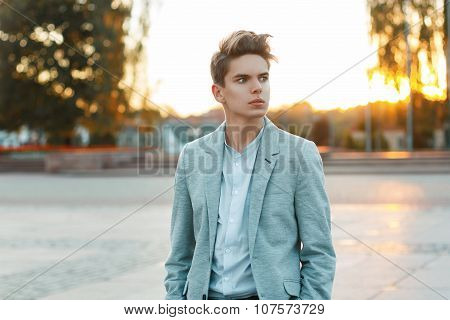 Handsome Young Businessman In A Jacket And Shirt Outdoors At Sunset
