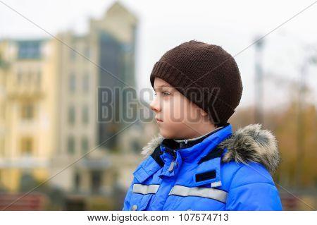 Boy In The Blue Jacket Looks Aside