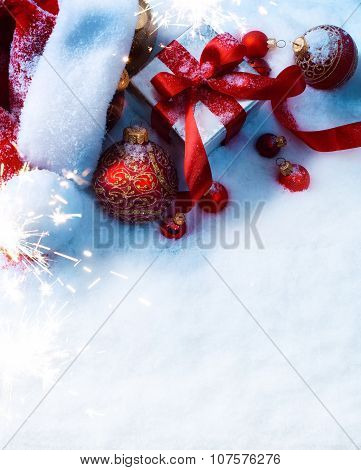 Art Christmas Background With A Red Ornament, Gift Box In Snow
