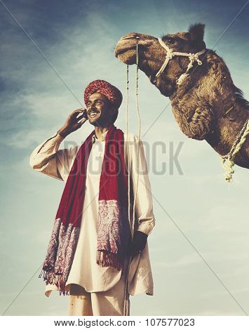 Indian Man On the Phone Camel Communication Concept