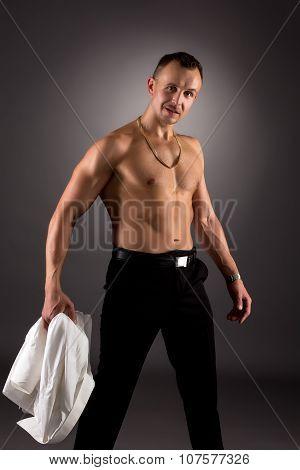Dancer took off his shirt and posing at camera