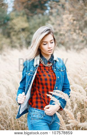 Beautiful Stylish Girl In Denim Jacket, Checkered Red Shirt And Blue Jeans.