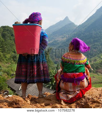 Vietnamese Hmong women standing on the side of a mountain pass