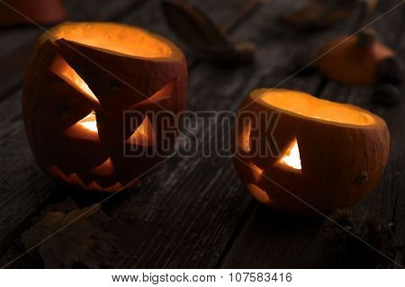 Concept Of Glowing Carved Hokkaido Pumpkins For Halloween Selective Focus