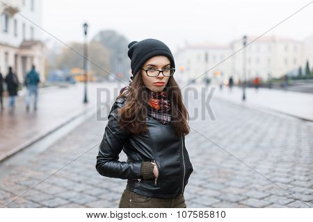 Fashion Look.glamor Lifestyle Brunette Woman Model In Black Leather Jacket And A Black Knitted Cap O